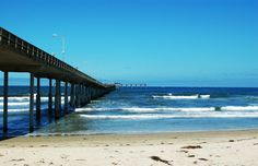 """Ocean Beach Pier-  The Ocean Beach Municipal Pier, one of the most remarkable landmarks in San Diego County, was officially opened and introduced to eager San Diegans on July 2, 1966. Over 7,000 of San Diego's then 600,000 residents were present to celebrate the opening, including local politicians Mayor Frank Curran and California Governor Edmund G. """"Pat"""" Brown who had the honor of cutting the ribbon."""