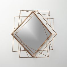 frame work. A sculpture for your wall, three dimensional looking glass reflects a flattering copper glow. Just right for an empty wall or entryway.