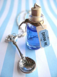 alice in wonderland party favor filled with flavored colored vodka