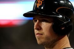 Buster Posey #28 of the San Francisco Giants waits to bat against the Los Angeles Dodgers at Dodger Stadium on September 12, 2013 in Los Ang...