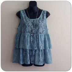 """Crocheted Ruffled flower Print Top Sea foam green crocheted top with a flower pattern. Sleeveless. Size large. 100% Polyester. See through.  Hand wash cold. 21"""" in total length. Adorable ?? Boutique Tops"""