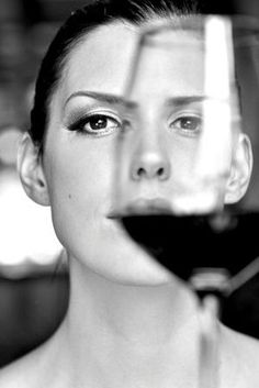 Woman and glass of wine.