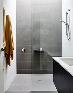 Recreate this bathroom look using our popular Cemento (concrete-look porcelain) series!