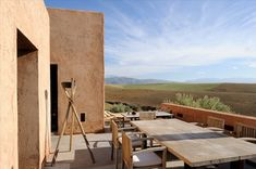 This vacation vila is located in Morocco and it's blending perfectly with the stunning landscape surrounding it. The exterior formed by earthen blocks reminds the traditional houses in the ar…