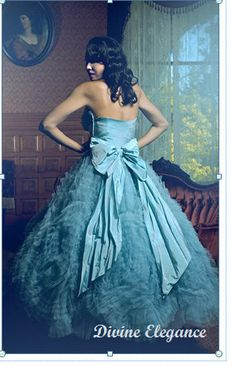 vintage blue tulle gown...  blue strapless ballerina-esque beauty has 3 layers of tulle netting with a thick blue satin lining in between. The waist is beautifully crafted of satin and a lavish blue satin ribbon train. This is what the 50's gowns were all about!