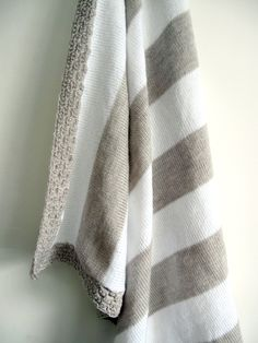 Beige and white knitted baby blanket. £20.00, via Etsy.