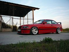 hellrot BMW e36 coupé on cult classic OZ AC Schnitzer type 1 wheels