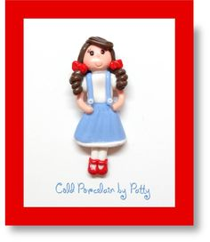 Dorothy Girl, Wizard of Oz Inspired Flatback Figurine, Cold Porcelain, Clay Center, Magnet, Pin, Pendant - READY TO SHIP. $4.95, via Etsy.