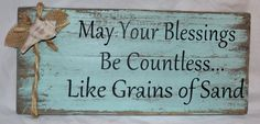 Beach Decor, Coastal Decor, Hand Painted, Distressed Wood Sign May Your Blessings Be Countless Like Grains Of Sand. $22.00, via Etsy.