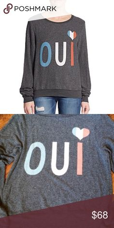 🆕Listing! Wildfox Oui Sweatshirt Wildfox grey Oui sweatshirt. Letters and heart  are in red, white, and blue. Pre-pilled, super soft and comfy. Graphic is not as vibrant as in stock photo, they're a bit more faded. Size S. Not oversized like some. Fits TTS. Very stretchy. In great condition. ❌NO TRADES ❌NO LOWBALLING❌ Wildfox Tops Sweatshirts & Hoodies
