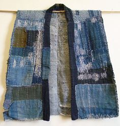 "Sri Threads:  ""A heavily patched and mended sakiori–or rag woven–sleeveless work coat.  To appreciate the cotton patches and eccentric hemp mending stitches, I'm showing this sodenashi inside-out."""