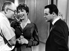 Billy Wilder directing Shirley MacLaine and Jack Lemmon on the set of The Apartment