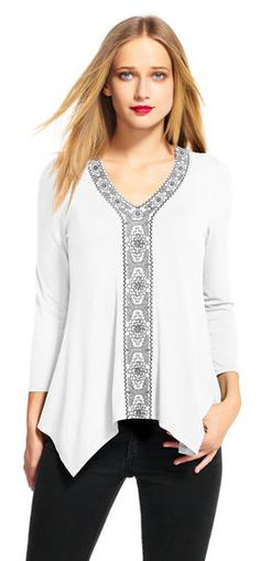 Adrianna Papell | Three Quarter Sleeve Hanky Hem Top with Embroidery | Embroidered details and a unique hem add an unmistakably bohemian touch to this three quarter sleeve top. This top features three quarter sleeves, a v-neckline, and a hanky hem for a casual look. Embroidered trim plays up the neckline and accents the center panel of this top. Paired with a slim pant and heels, this casual top is set for the day.