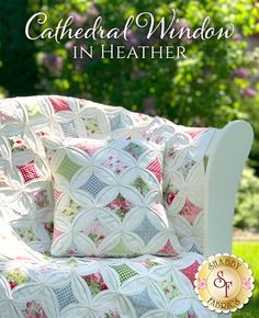 """Cathedral Window in Heather Quilt & Pillow Kit Create a romantic masterpiece with the Cathedral Window In Heather Quilt and coordinating pillow! This stunning quilt is sure to wow your friends and family with its intricate and complex look, but it is so much easier than it looks! This Shabby exclusive is made with our gorgeous fabric collection, Heather. Quilt finishes to approximately 36"""" x 54"""". Pillow finishes to approximately 13½"""" x 13½""""."""