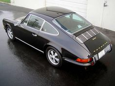 Porsche 911s black and silver for the autobahn but as Kirsty says she'd rather have a softer colour and belt it round our rural roads
