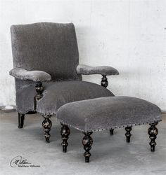"""Armchair  AddThis Sharing Buttons Share to PinterestShare to FacebookShare to TwitterShare to EmailShare to More Warm Gray, Plush Chenille Covering With An Aged Black Finish On A Solid Hardwood Frame Featuring Mahogany Turned Legs And Arm Posts, And Antiqued Brass Nail Accents. Seat Height Is 19"""". Matching Ottoman Is Item #23641. Ships in 3-5 business days SKU: DSTUC23640 Dimensions: 42 h X 33.6 w X 33.5 d (inches) Weight: 68.20lb"""