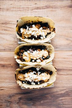 a quick and healthy recipe for chicken tacos with black beans, kale, romesco yogurt sauce and feta cheese. | www.nyssaskitchen.com