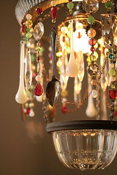 Chandelier of found objects...  I am SO doing this to replace the lost crystals on moms lamp!