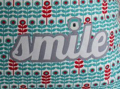 Smile Pillow Applique detail by IveteTecedor, via Flickr, brr fabric by Laurie Wisbrun