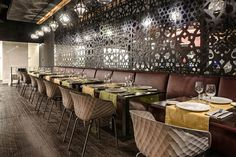Uni-Ka padded polypropylene chairs with a wooden base at D'Sesto in Madrid, Spain.    Hospitality, Design, Restaurant, Dining, Seating, Furniture, Lifestyle, Travel, Interior