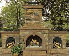 This Cambridge outdoor fireplace is crafted using our stone veneer!