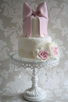 Put individual cake on a pretty cake stand at each table