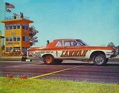"""Al Eckstrand, launches his 1964  426 Max Wedge Plymouth """"Lawman"""" in SS/A. He had won Stock Eliminator the previous year driving for the Dodge Ramcharger team. That was the first time an automatic car had won Stock Eliminator."""