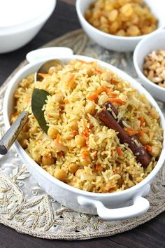 Bukhari Rice Bukhari Rice is an aromatic and flavorful Middle Eastern rice dish that features numerous spices to evoke its namesake--the Silk Road city of Bukhara. Middle Eastern Rice, Middle Eastern Recipes, Middle East Food, Middle Eastern Vegetarian Recipes, Lebanese Recipes, Indian Food Recipes, Ethnic Recipes, Arabic Recipes, Arabic Rice Recipe
