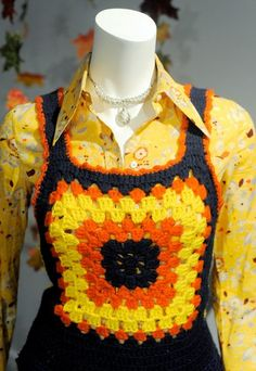 """A hand-crocheted granny square vest from the 1970s. I remember the teen age """" cool girls """" wearing these when I was a little girl"""