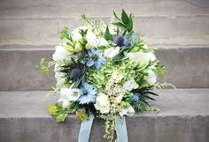 Good mix of white flowers, foliage and sea holly - good balance.  But tied with garden twine for a more natural look.