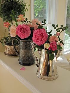 Antique Silver Tankards as Flower Vases