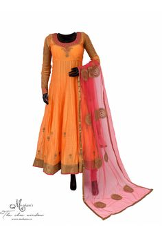 Elegant pale orange and pink anarkali in zari work