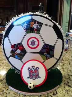 Soccer centerpieces for banquet. Double sided with all the players pictures. Varsity, junior varsity and jv2. Created 22 centerpieces.