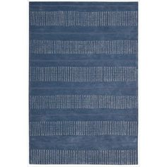 This hand-crafted rug will add a stylish element to any area. Its blue with white horizontal stripes pattern is modern and attractive. Hand carved details add a stunning dimensional effect.