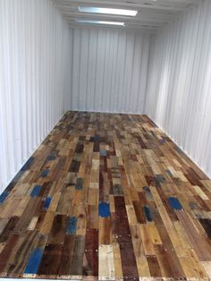 recycled pallet floor for finishing basement, with a nice polyurethane layer over it, this will be really nice.