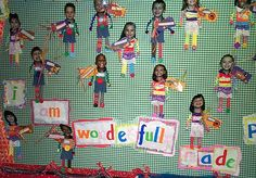 I Am Wonderfully Made              For this bulletin board, Mrs. Rudd took close-up pictures of the students. The body is a rectangle about four inches tall with the corners rounded which each child painted with tempera paint. Then they made a collage body using ribbon for the legs, rick rack for the arms, pom poms for the hands, and buttons for the feet. Scraps of eyelet were used for the girls' skirts. The background is checked fabric.
