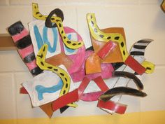 Frank Stella inspired sculptures. Using shapes, color, and patters to depict an activity and the way they feel while doing it.