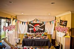 Pirate Themed Birthday Party - I love the names of the food, pirate teeth popcorn, squid hot dogs too cute!
