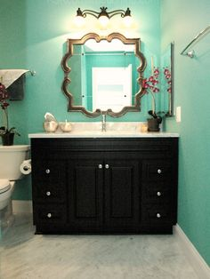 Love the shape of this  mirror for a bathroom- @Kellie Herrmann what about the mirror we saw the other day in my half bath???
