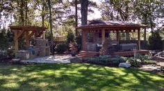 """A beautiful Outdoor Lifestyle Area! Complete with a super sexy """"Tea House"""" & an AWESOME Outdoor Kitchen, complete with a wood fired oven. Stone Masonry, Wood Fired Oven, Outdoor Kitchens, Fireplaces, Firewood, Pond, Gazebo, Outdoor Structures, Patio"""