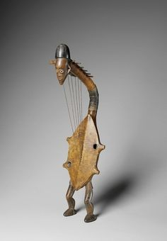 Africa | Musical instrument ~ Harp from the Ngbaka people of DR Congo | Early 20th century | Wood, hide and pigment