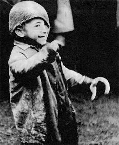 A smile in the midst of horror. Warsaw ghetto