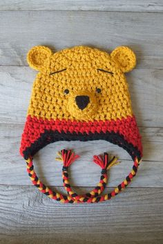"Winnie the Pooh ""inspired"" Hat w/Earflaps and Braids  (Newborn-3 month / 3-6 month / 6-12 month sizes). $35.00, via Etsy."