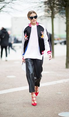 Pin for Later: Olivia Palermo Is the Master at Rewearing Clothes At London Fashion Week, Olivia threw the Topshop bomber over a white sweater and leather culottes for a cool-girl twist. Olivia Palermo Outfit, Olivia Palermo Street Style, London Fashion Weeks, Milan Fashion, Look Fashion, Star Fashion, Fashion Guide, Moda Lolita, Satin Bomber Jacket
