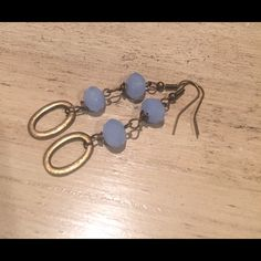 Blue crystal and brass metal earrings Two sky blue crystals hanging 2.5 inches from top to bottom. Brass metal ring and french wire. Jewelry Earrings