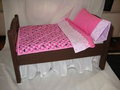 Wooden Doll Bed With Dust Ruffle Skirt. $69.99, via Etsy.