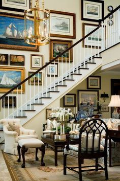 Gorgeous gallery wall going up the staircase in a traditional home.
