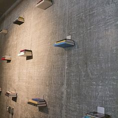 Invisible floating book shelf on concrete wall for guest bedroom.  #loft  #interiordesign  | Erikgarciadesign