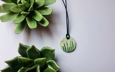 handmade clay necklace with plant impression
