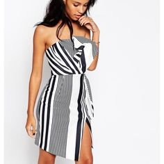 Gorgeous bow bandeau stripe dress with split Black and white stripe / bandeau/ hits above knee/ thigh split / zipper closure in back / true to size / beautiful / worn once Dresses Mini